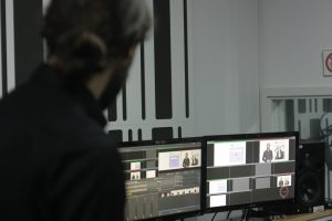 In the studio, recording a presentation video for the project